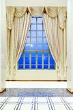 Glass window and luxury yellow blinds. With blue sky royalty free stock photo