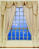 Glass window and luxury yellow blinds. With blue sky stock image