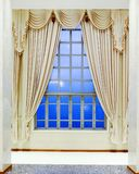 Glass window and luxury yellow blinds. With blue sky stock photography