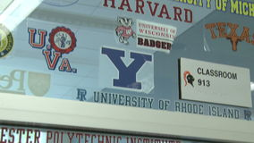 Glass window with names of potential colleges  (2 of 3) stock footage