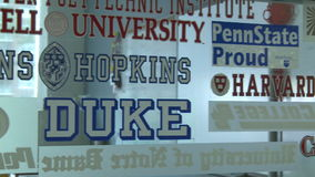 Glass window with names of potential colleges  (3 of 3) stock video