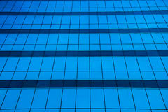 Glass window office building background. Shade of glass window office building, abstract texture of blue glass modern building skyscrapers and sky reflection Royalty Free Stock Images