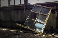 Glass window panes in abandoned building Royalty Free Stock Photos