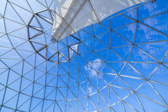 Glass window skylight dome with blue sky, metallic structure Stock Photography