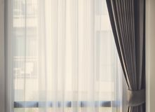 Glass window with white translucent curtain Royalty Free Stock Images