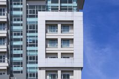 Free Glass Windows And Balcony On Exterior View Of Modern High Building With Blue Sky Royalty Free Stock Photography - 195474437