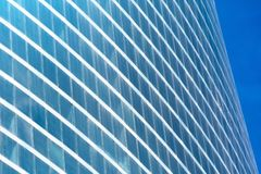 Glass windows arc curved in a semicircular skyscraper. Glass windows arc curved in a semicircular skyscraper Royalty Free Stock Photography