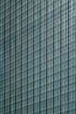 Glass windows of building. The glass mirrors of a tall building Royalty Free Stock Images