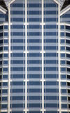 Glass Windows in Building. Rows and rows of glass windows in building Stock Image