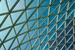 Glass windows grid on blue sky. Abstract background Stock Image