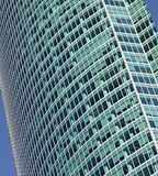 Glass windows of a skyscraper. Abstract background of glass building`s windows Stock Photos