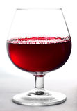 Glass of wine. On a white background Royalty Free Stock Image