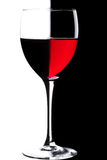 Glass of wine. Glass of red wine over black and white background royalty free stock images
