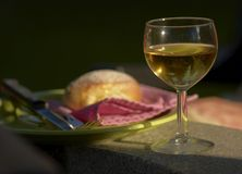 Glass of wine. A glass of white wine with side dish Royalty Free Stock Photo