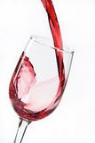 Glass of wine. Pouring wine into a wine glass Stock Photo