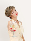Glass of wine. Woman in a formal dress having a glass of wine Stock Image