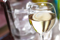 Glass of wine. With a glass of ice in background stock photo