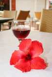 Glass of wine,. And tropical flower Stock Photos