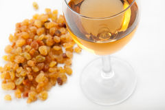 Glass of wine. The wine glass costs near to raisin stock images