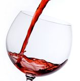 Glass of wine. Red wine being poured in a glass Royalty Free Stock Image