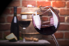 Glass of wine against a brick wall Royalty Free Stock Images