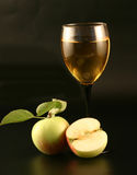 Glass of wine and apples Stock Images