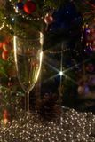 Christmas moods. A glass of wine on the background of Christmas trees and Christmas decorations royalty free stock image
