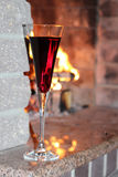 Glass of wine on a background of fireplace Royalty Free Stock Photography