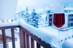 Glass of wine on balcony balustrade in hotel suite Stock Photo