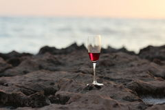 A glass of wine on the beach. stock images