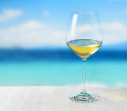 Glass of wine. On beach background stock photography