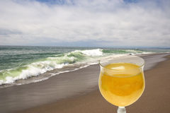 Glass of Wine on the Beach. A solo glass of Northern California white wine on a Southern California beach stock photo