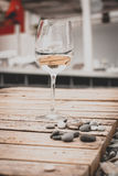 Glass of wine on the beach stock photo