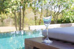 Glass of wine on the bed Royalty Free Stock Photos