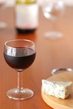 Glass of wine with bottle Stock Image