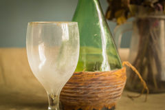 Glass and wine bottle with dust Royalty Free Stock Photography