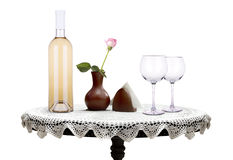 Glass of  wine and a bottle with flower Stock Images