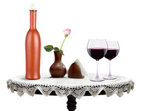 Glass of  wine and a bottle with flower Royalty Free Stock Photos