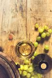 Glass of wine, bottle and green grapes Royalty Free Stock Photos