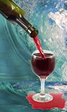 Glass of wine and a bottle on water background Royalty Free Stock Photography