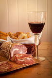 A glass of wine, bread and salami. Delicious Mediterranean snack: red wine with salami and home-made bread Stock Photo