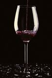 A glass of wine with broken glass Royalty Free Stock Images