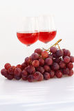 Glass of wine and a bunch of grapes Royalty Free Stock Photography