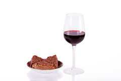 Glass of wine with a cake Stock Images
