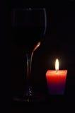 Glass. Wine candle light background dark still life fire minimalism romantic sweet warm night Royalty Free Stock Photo