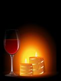 Glass of wine and candles. Romantic evening. Glass of wine and candles Royalty Free Stock Image
