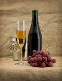 Glass of wine and a champagne bottle Royalty Free Stock Image