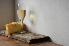 A glass of wine and cheese Royalty Free Stock Photography