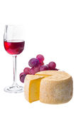 Glass of wine, cheese and grapes on white Stock Photos