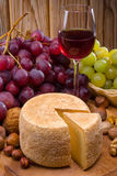 Glass of wine, cheese and grapes Royalty Free Stock Images